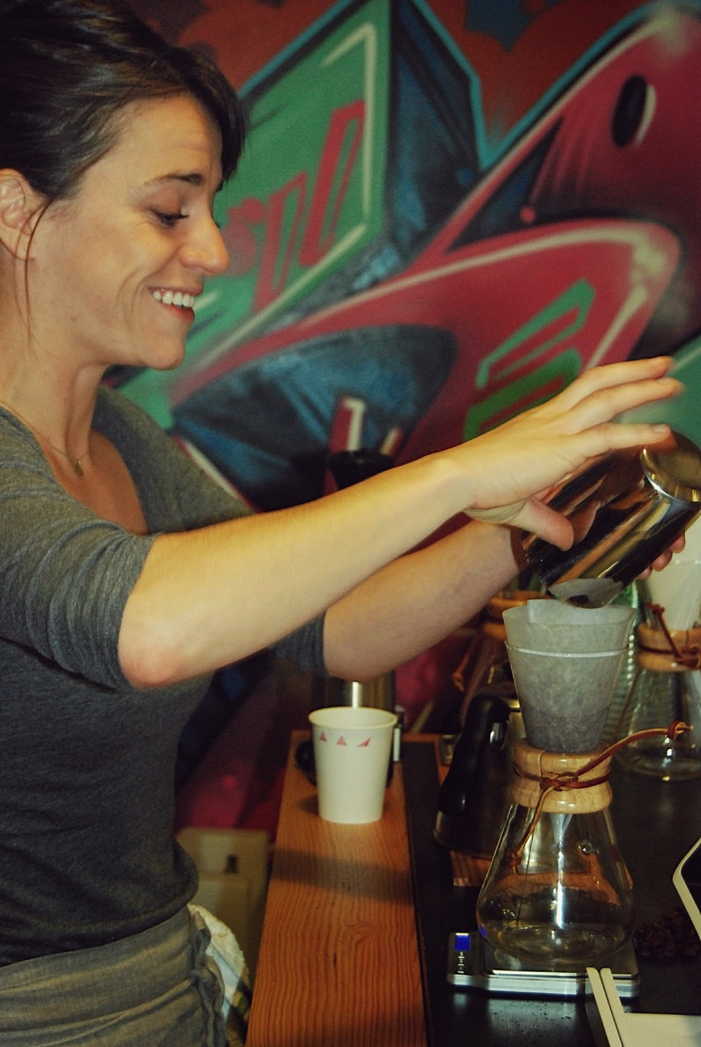 Annie Groff, Triangle Coffee co-founder, pours coffee into a Chemex.