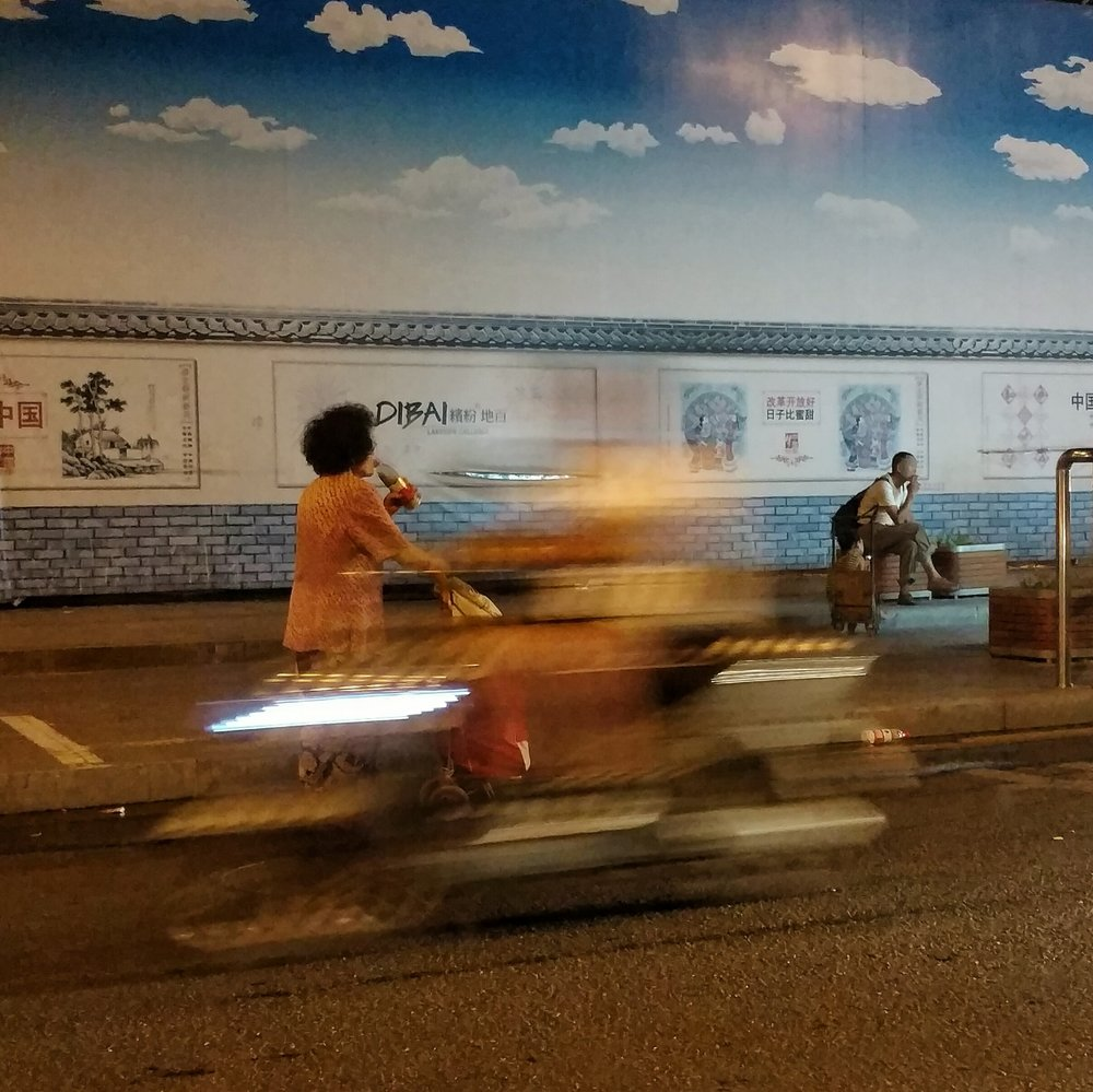Moving fast and slow in Beijing.