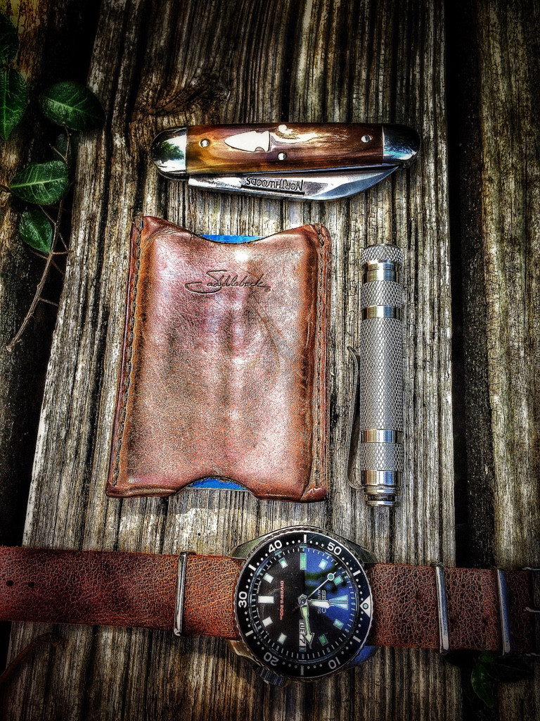 notaknife :     Nice HDR photo of a super simple EDC.    Leather. Wood. Worn. Automatic.    Nicely done.