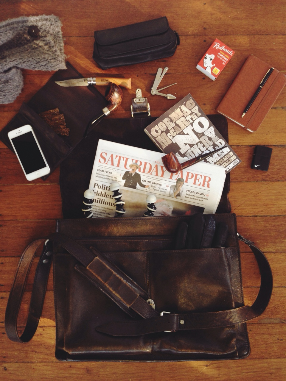 "thesillyoldbear :     What's in my bag?    •7"" Opinel  •Pipes - Comoy's Tradition & Peterson Irish Army 999  •Tobacco pouches w/ Orlik Golden Sliced & my Opium Den blend  •Pipe Zippo, czech tool & spare matches  •Notepad & pen  •The Saturday Paper  •Cormac McCarthy's No Country For Old Men  •Gorillapod  •iPhone 5  •Driving gloves & scarf"