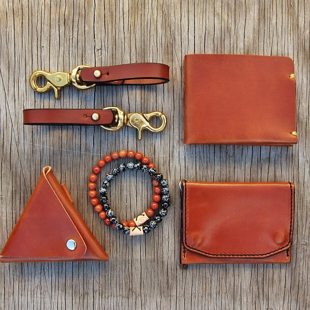 fridayandriver :     A selection of items featuring our newest color Whiskey: Triangle Coin Pouch / McGraw Wallet (top) / Thornwood Wallet. Pictured with Belt Lanyards and Stone Bracelets. #leathergoods #edc #whiskey