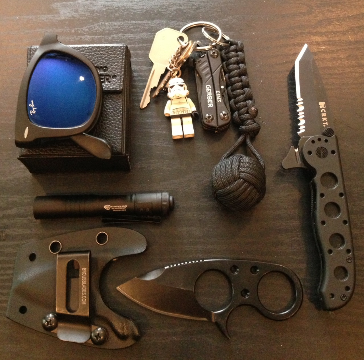 realworldedc :       Tyler   strikes again!      Matte Black Ray Ban Folding Wayfarer   Keys, Stormtrooper Lego Figure, Gerber Dime Multitool, Black Monkeyfist With One Inch Ball Bearing And Cobra Paracod Knot   Streamlight Microstream Flashlight   Brous Blades Silent Soldier V2 with Kydex Sheath   CRKT M16-12 ZLEK Flipper Knife With Safety Seatbelt Cutter And Window Breaker         http://www.dailycarry.co