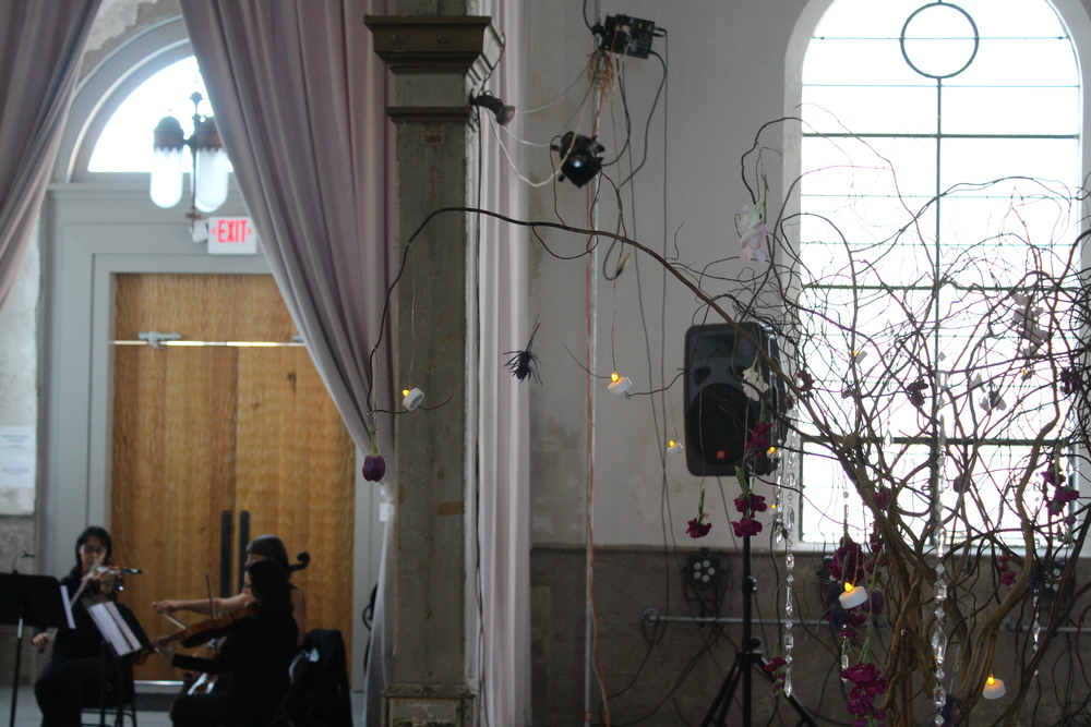 This is a picture of a speaker setup nicely behind a curtain at the Marigny Opera House in New Orleans, LA. (Where Solange got married) Sorry, Violinists not included.