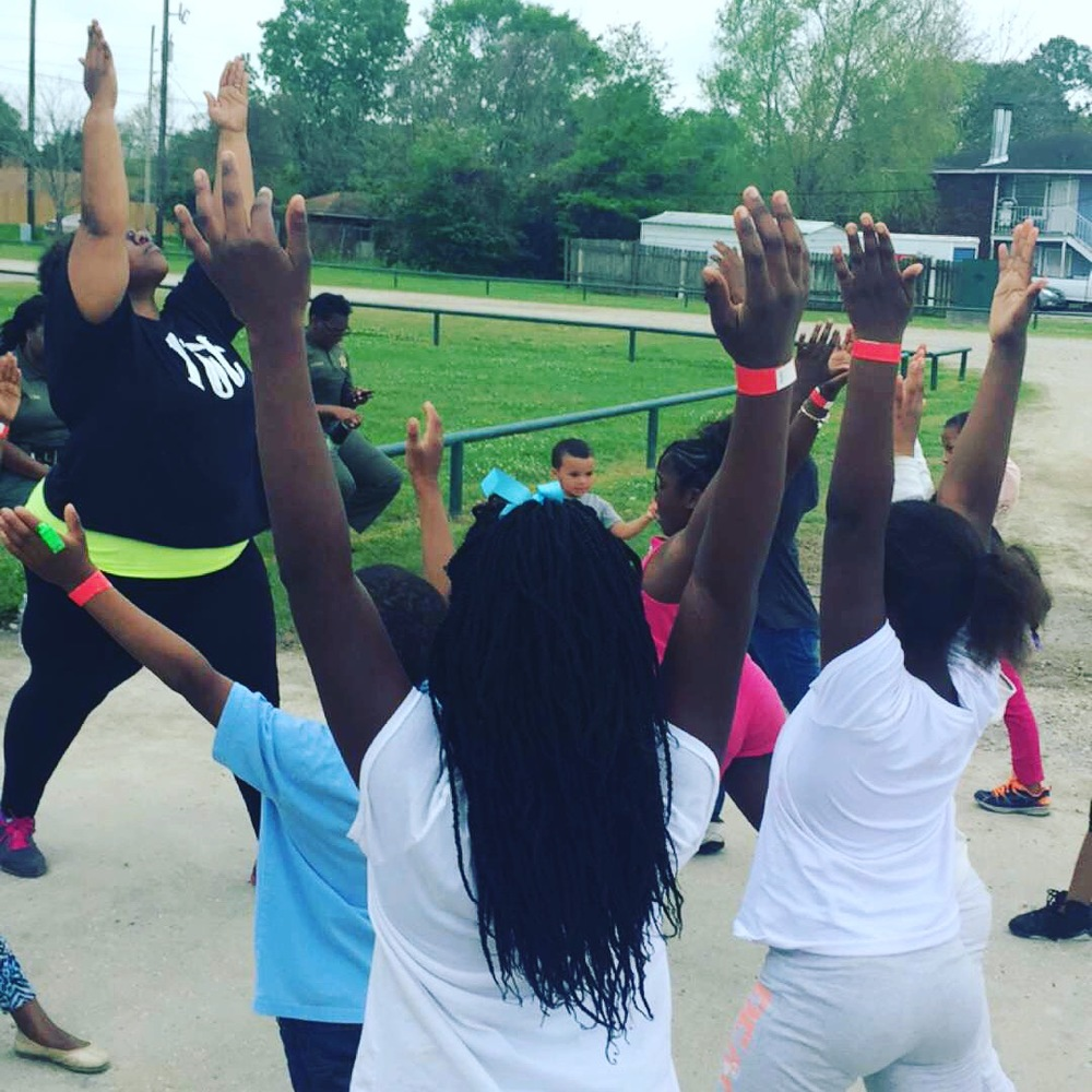 "Tanya and I doing 'Zumba and Meditation in the Park' for the Gardere Initiative. Teaching all the kids to ""Let it Go"""