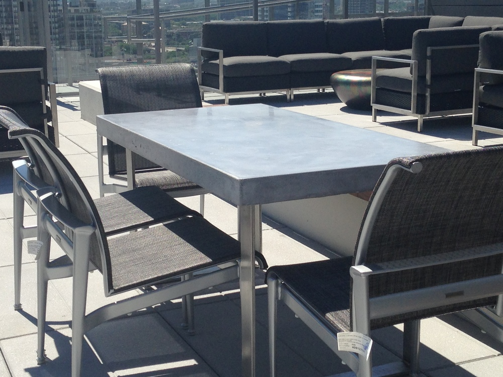 Inhabit Concrete Design - Catalyst 60x30 GFRC Table with Stainless Steel Base.JPG