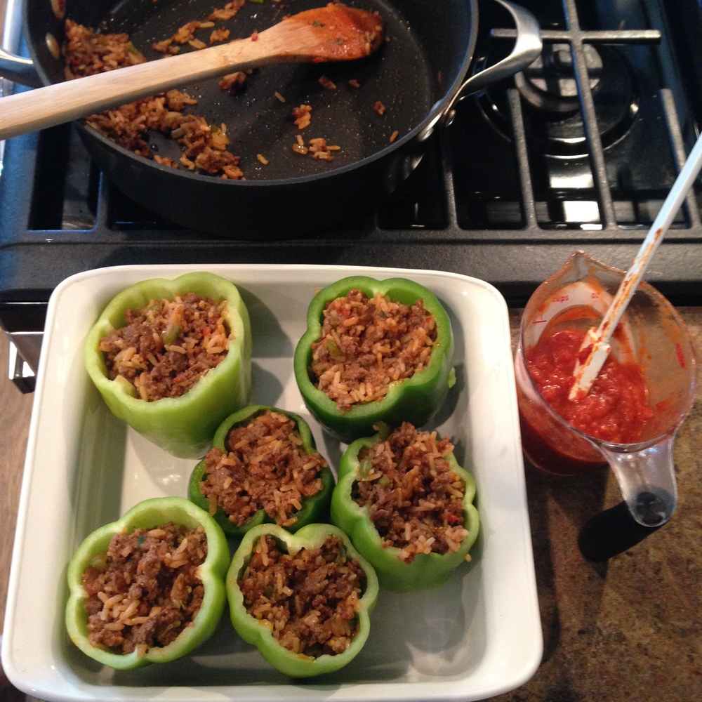 Work in progress! Filling the peppers and waiting to top them with sauce and cheese!