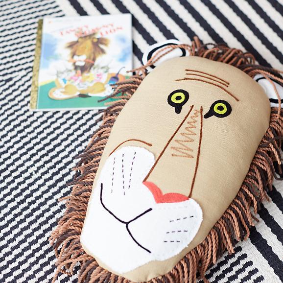 tawny-scrawny-lion-throw-pillow-1.jpg