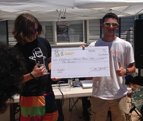 Owners Dominic (left) and Luke (right) donating $1,000 to Children's Hospital at the 2013 Fairfax Skate Fest
