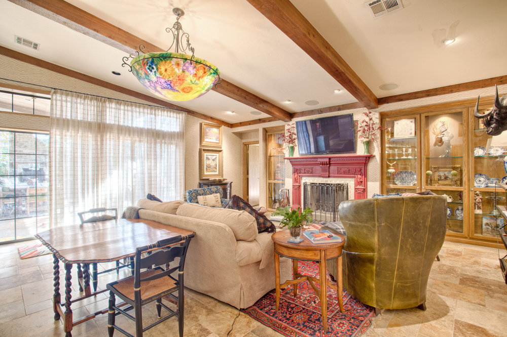 Family room and fireplace.  Opens to the kitchen.jpg