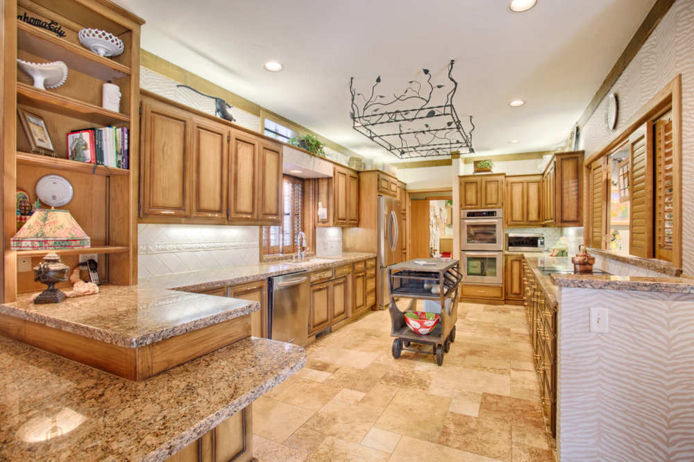 Kitchen opens to both living areas..jpg