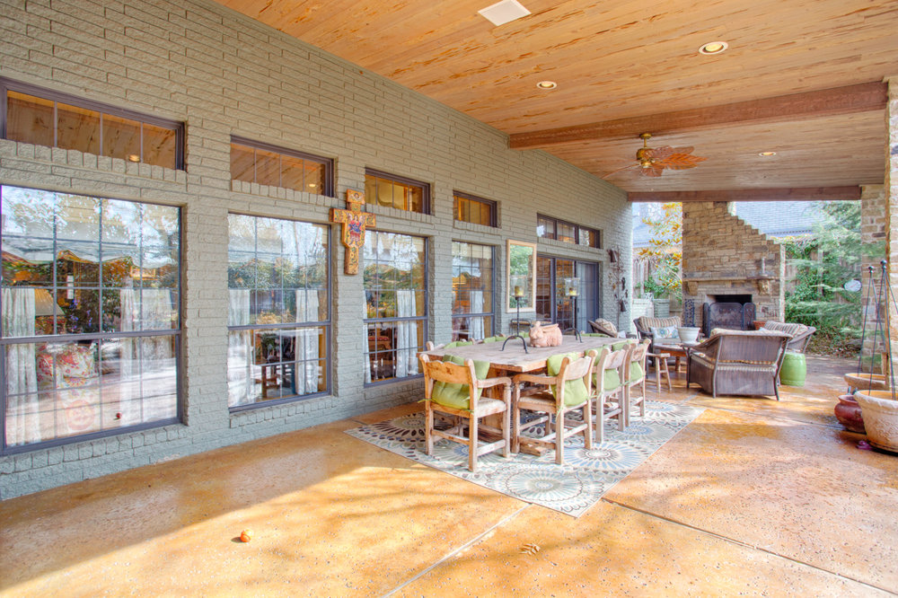 Patio living and dining with vaulted Pecky Cypress ceiling and fireplace.jpg