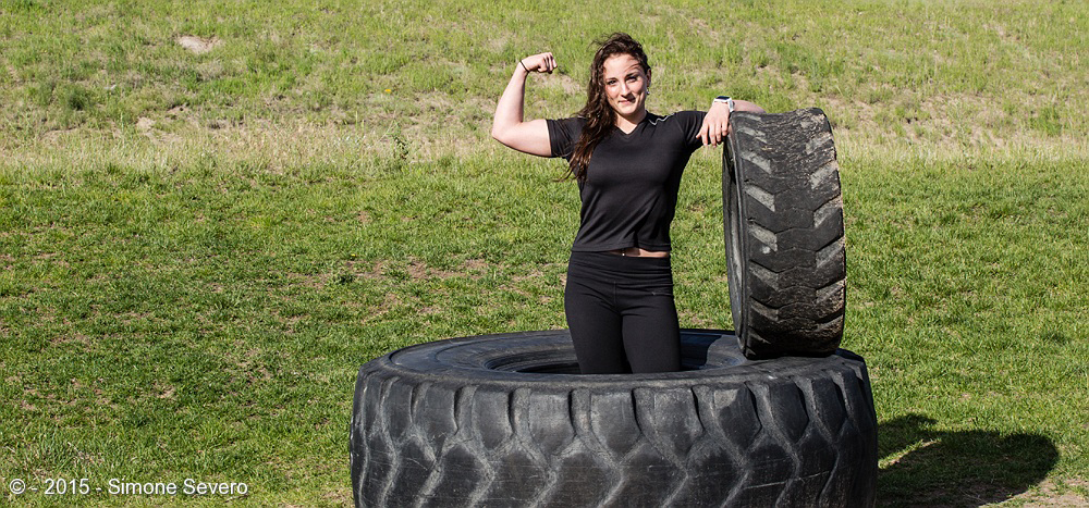 Rebecca is a personal trainer, very strong and powerful. Definitely an inspiration for those who work out around her. I was lucky she had a small window of time to share with me and we were thinking alike: we both talked about taking her portrait with the tractor tires!  I tried a few ones where she was doing push ups but the wind covered her had so I ended going with this one that only the natural light was used.  She also loves photography, she works a lot and she spends quality time with her family, boyfriend and friends.