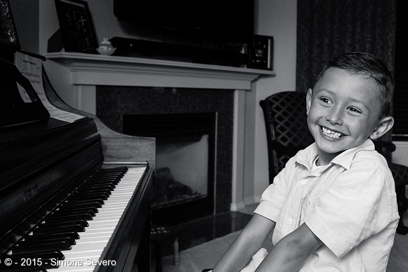 Marcelo started playing the piano when he was 3. His grandma got him started twice a week while he was on vacation with her. He is almost 7 years old now and he still loves music. While I was photographing him he was smiling and giggling the time. He is the youngest piano player I ever met.  He moved from Alaska one year ago, he has a fish called Dori and he loves reading. He played jurassic Park for me with a big smile on his face. He learned by ear, first then he got the papers to follow.  He loves his grandma and he is lucky to have her around. He said the best thing of moving from Alaska to Colorado is that his grandma is here.