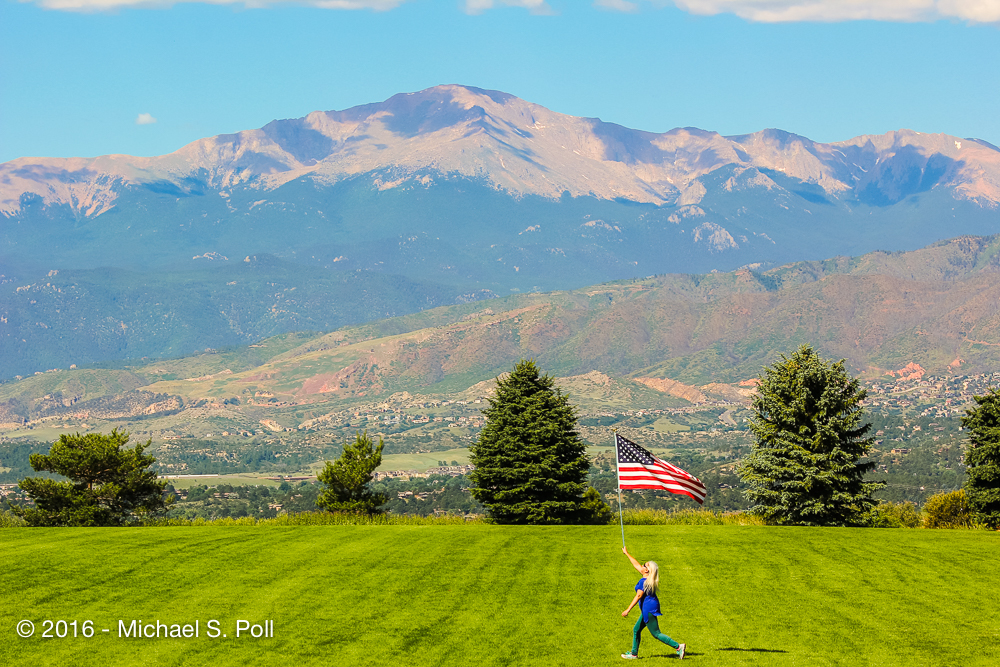 This is me, celebrating my 5th American birthday. I wanted to run in front of my mountains with the biggest flag I could carry :)