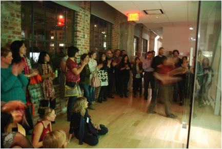 Audience watches dancers in Gensler office