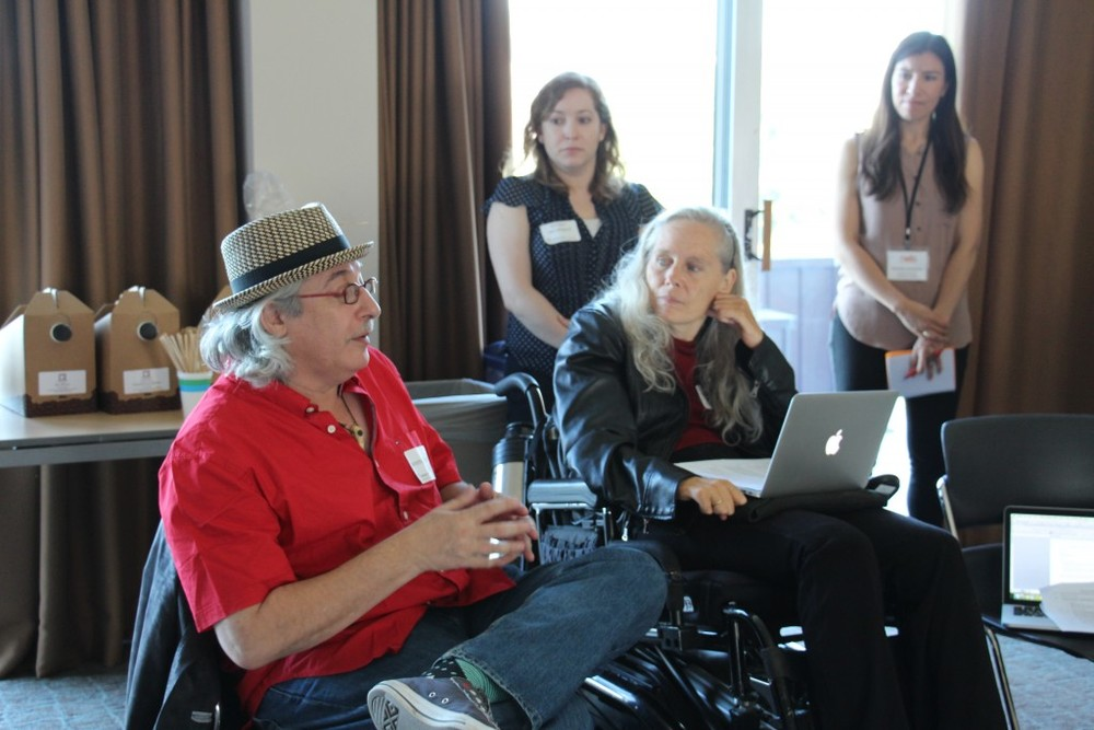 Jeremy Alliger, who produced the first International Festival of Wheelchair Dance in Boston in June 1997, reminisces with Judith Smith, co-founder and artistic director of AXIS Dance Company, while Kristen San Miguel of BDA and Daniela Jacobson of NEFA listen.