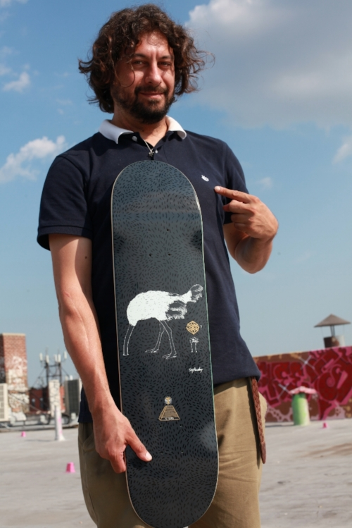 Soy holds the new Fall 17 collab board he designed for the Theories 10 year anniversary