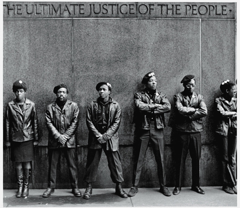 View of a line of Black Panther Party members as they stand outside the New York City courthouse under a portion of an Abraham Lincoln quote which reads 'The Ultimate Justice of the People,' New York, New York, April 11, 1969. (Photo by David Fenton/Getty Images)