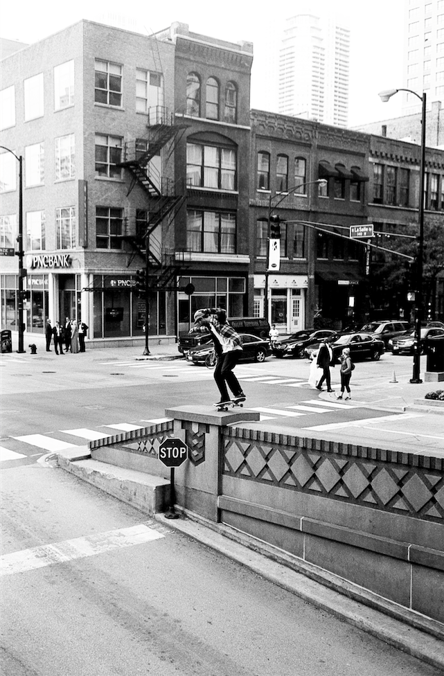 Kevin Coakley nollie nose wheelies an amazing spot. Photo by Richard Hart