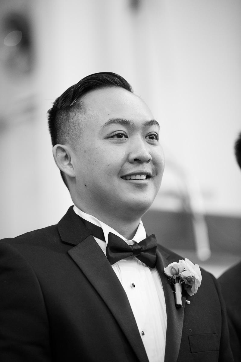 Groom smiling on wedding day
