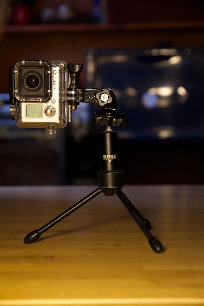 GoPro with 3-way pivot arm atop a baby tripod.