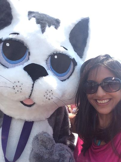 Sana with a giant cat (not available for adoption).