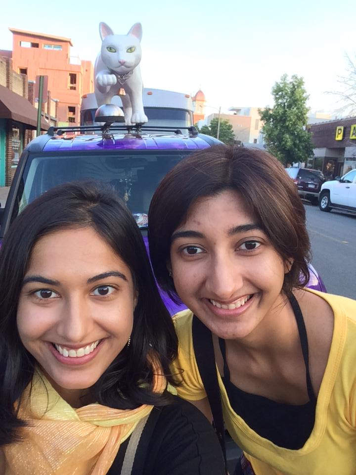 Sana and her sister at the opening night of Acro-Cats at Denver's Bug Theatre, posing in front of the Acro-Cat van.