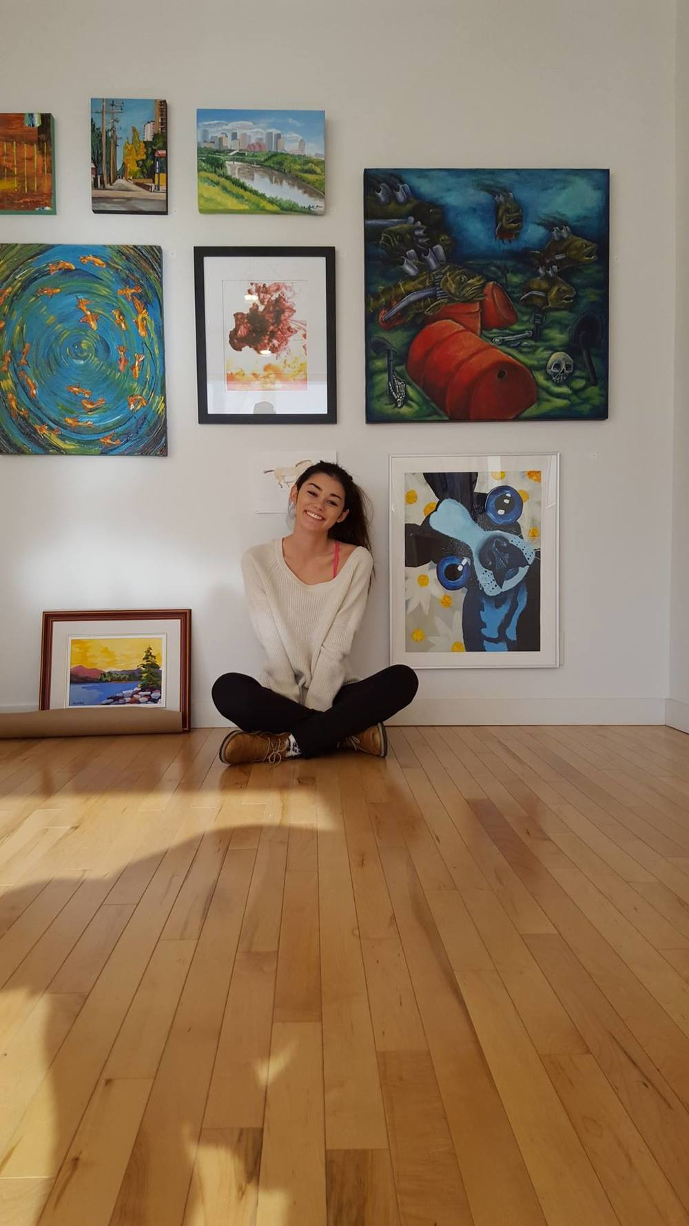 "Artist Sam Hoshizaki poses next to her painting of ""Daizy"" (her own dog)."