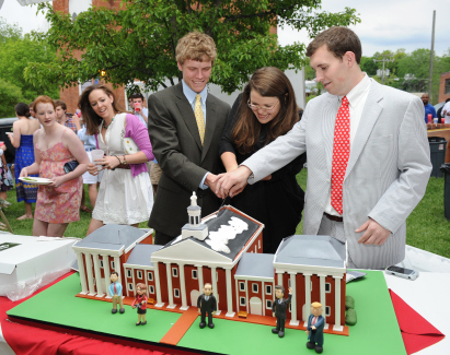 The Colonnade Cake,by Baltimore's Charm City Cakes, being cut by the 2012 Tri-Chairsat Spring Kickoff 2011.