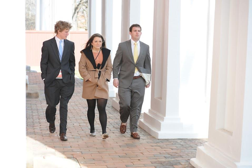 General Chair Tricia King '12 (center), Personnel Chair Tucker Pribor '12 (left), and Political Chair Zach Wilkes '12 (right), walk the Colonnade before the fourth and final session of Mock Convention 2012.