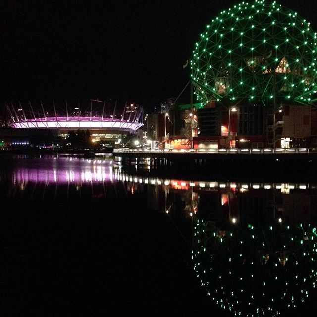 Vancouver was glowing in our colours last night! So cool!  #Vancouver #scienceworld #bcplace #nighttime #falsecreek #seawall