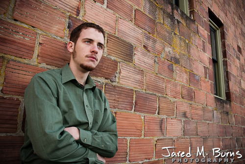 Duvall Cedarcrest Senior Guy Portrait Photographer - Carnation - Leaning on brick wall