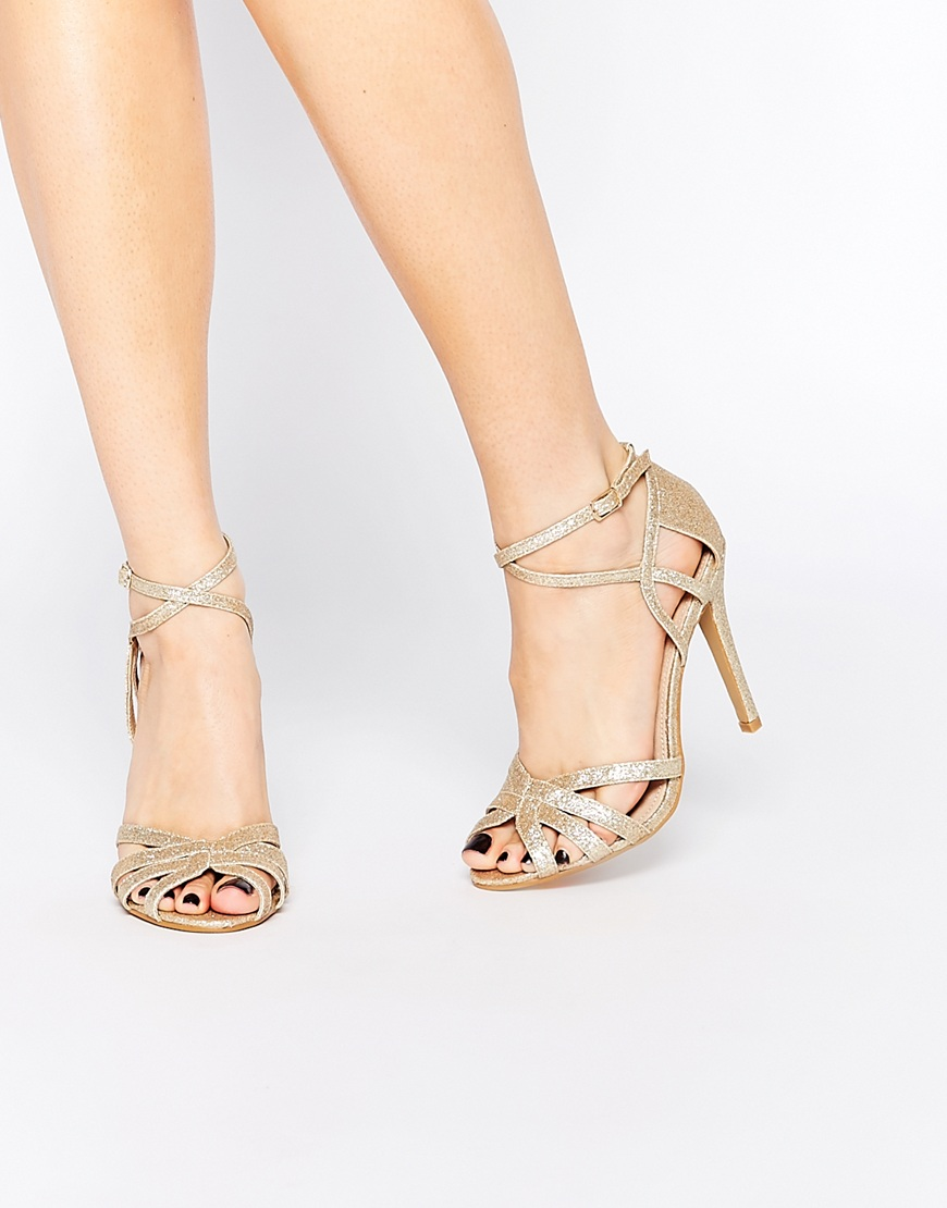 Source - http://www.asos.com/True-Decadence/True-Decadence-Gold-Glitter-Ankle-Strap-Heeled-Sandals/Prod/pgeproduct.aspx?iid=6020863&cid=4172&Rf-200=26,11&sh=0&pge=0&pgesize=36&sort=-1&clr=Goldglitter&totalstyles=101&gridsize=3