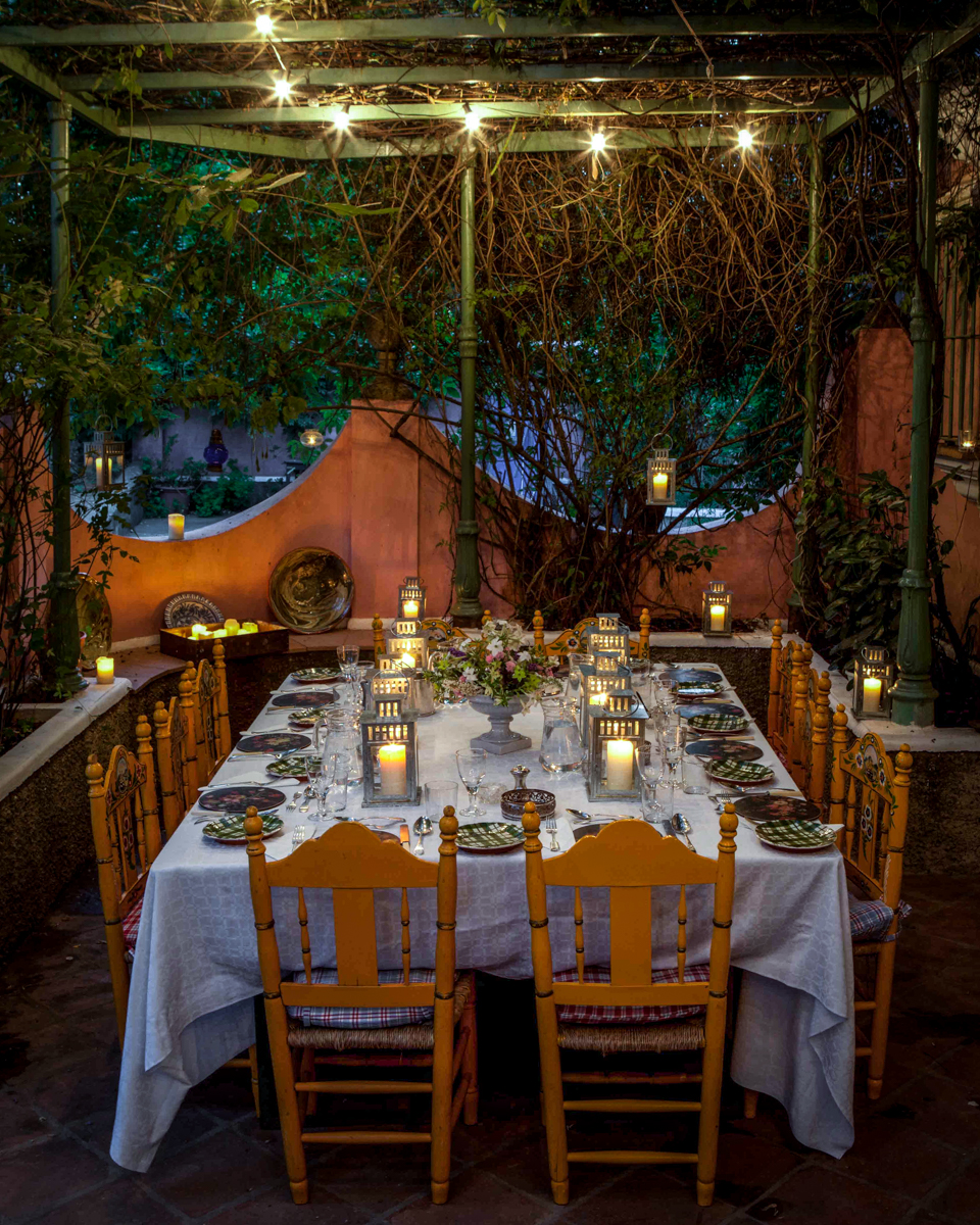 A table is set for dinner during a food and travel photo workshop at Finca Buenvino in Andalucia, Spain