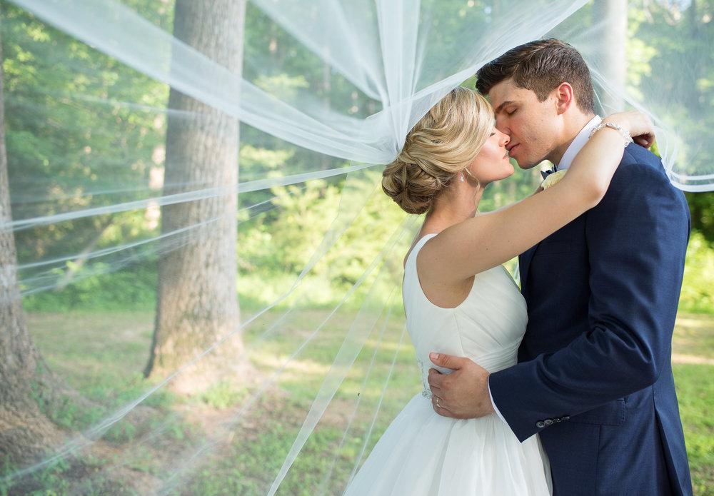 alex and ches veil kiss).JPG