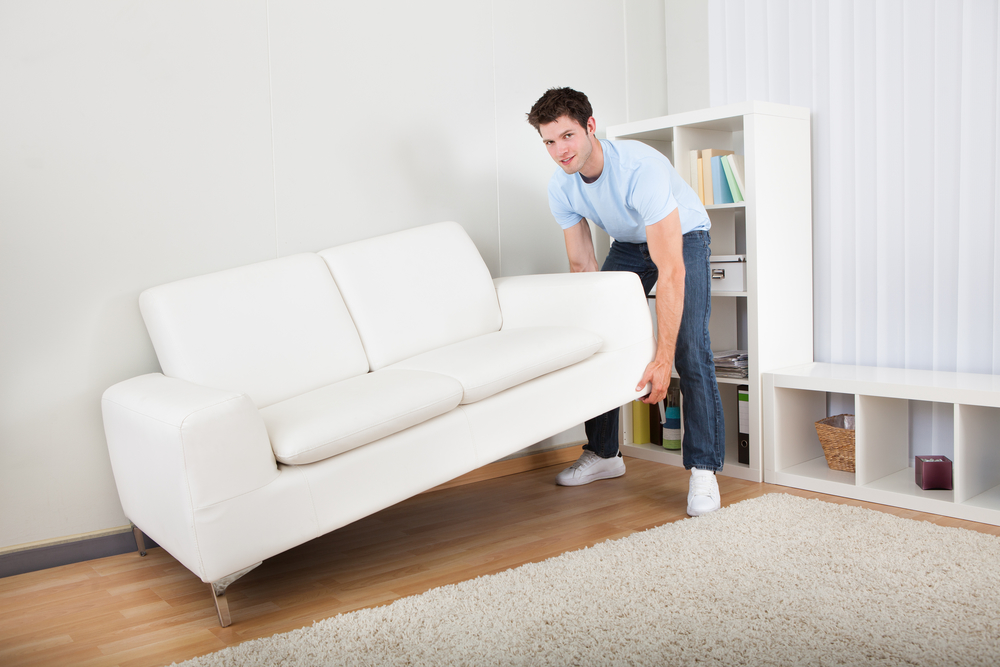 man lifting couch.jpg