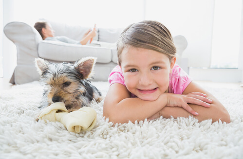 girl and dog on carpet.jpg