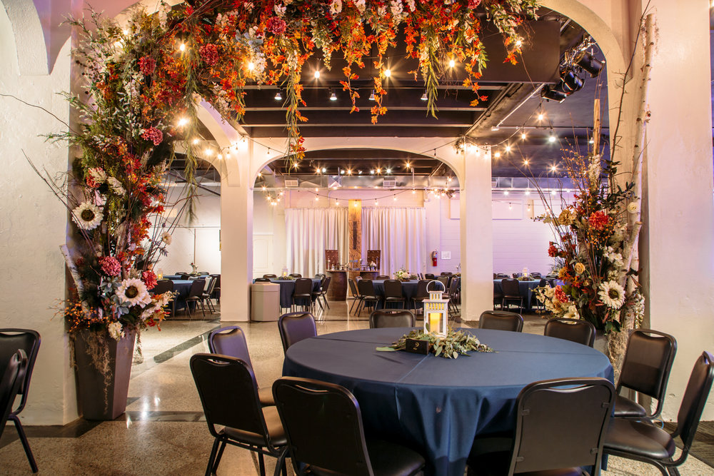 The Lower Ballroom includes a seasonal floral display in the grand entry arch, created by J Smith Events.