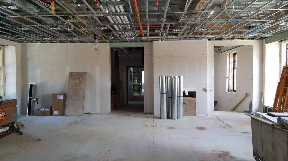 Ceiling grids and other fixtures move Landry House one step closer to completion.