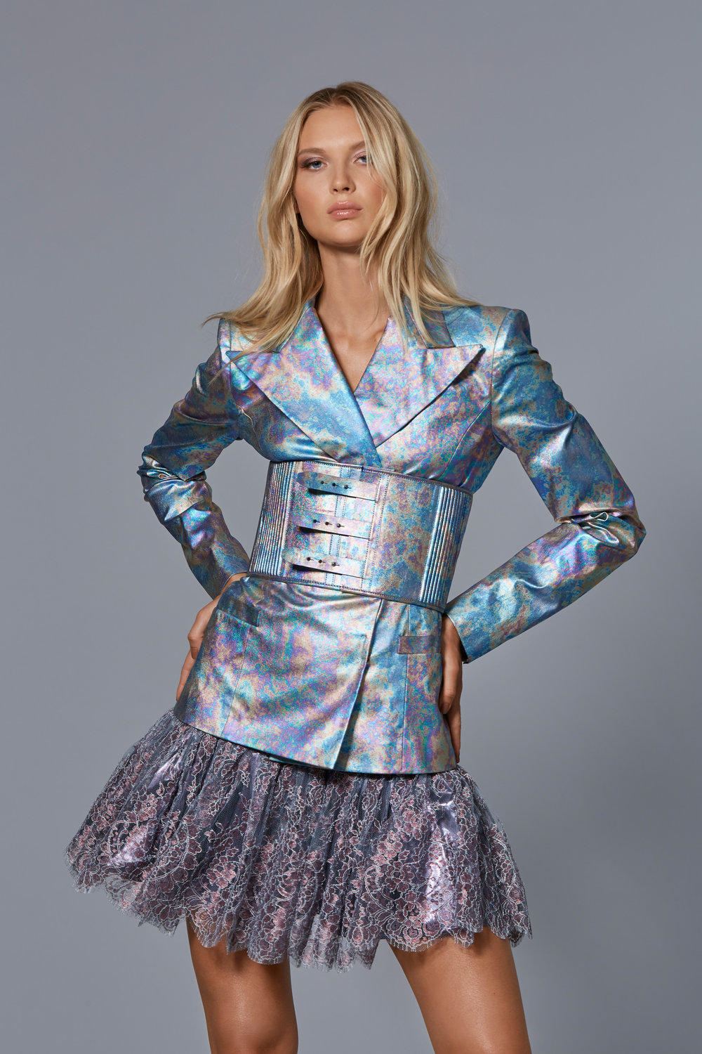 CLAUDIO CINA   LOOK 4:  Metallic Vegan Leather Jacket With Matching Corset Belt  Metallic Lace Mini Skirt