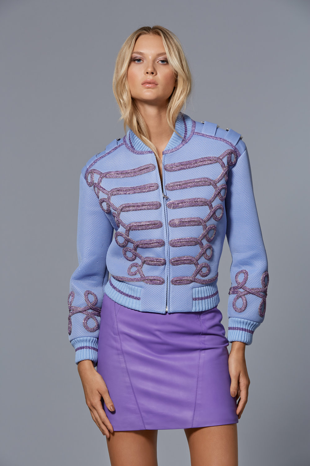 CLAUDIO CINA   LOOK 6:  Mesh Neoprene Bomber with Embroidered Crystal Cording  Leather Mini Skirt