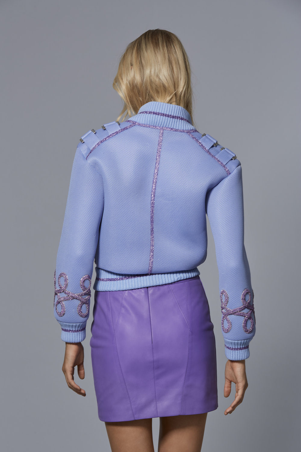 CLAUDIO CINA   LOOK 6: BACK VIEW  Mesh Neoprene Bomber with Embroidered Crystal Cording  Leather Mini Skirt