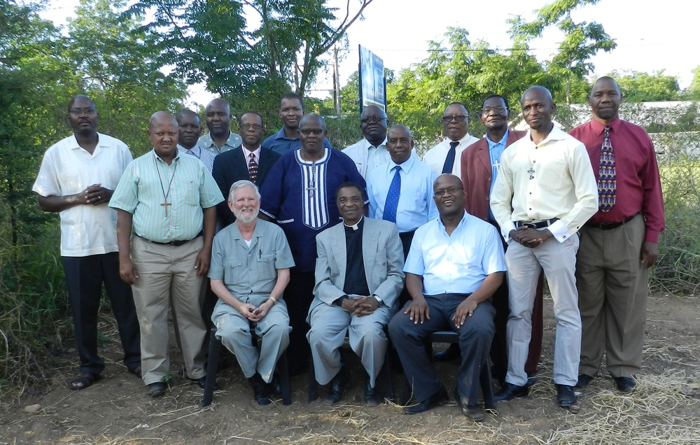 Seated: Fr. Leon Spencer, Fr. James Amanze, and Fr. John Hamithi, lecturers, with ordinands