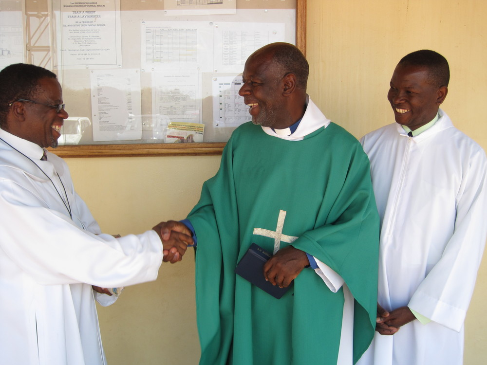 Ordinands Octavius Bolelang (left) and Bashie Tsheole                                with Fr. Andrew Mudereri