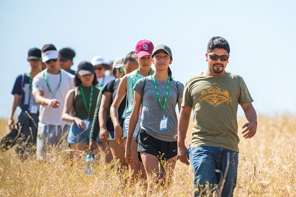 High School students at Youth Heritage Summit, a summer program by We Are the Next, walk Cesar E. Chavez's morning meditation hike with his grandson, Fernando Chavez