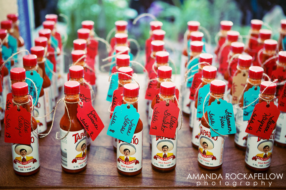 "There was an adorable sign, among others made by the Bride's Mom, telling guests to ""Find their seat, HOT STUFF!"" as they entered into the reception space."