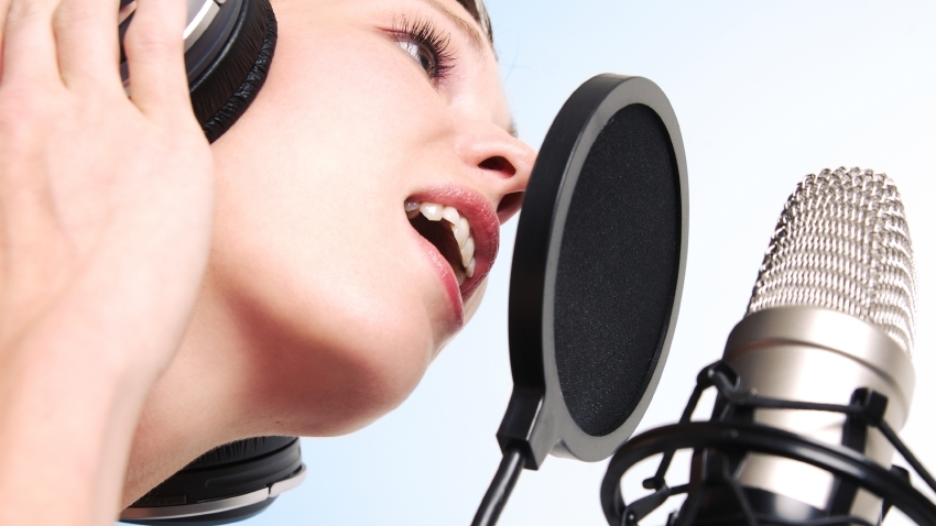 woman-recording-microphone-ear-phones.jpg
