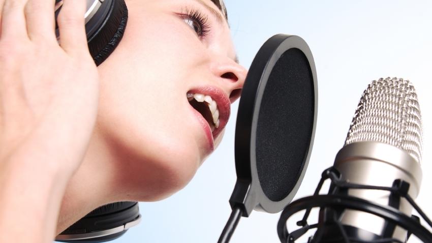 woman-recording-microphone-ear-phones.jpg
