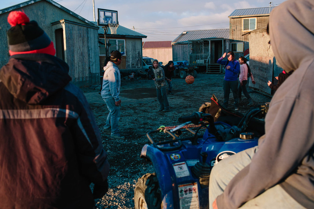 Teens in Togiak play basketball, a favorite sport among rural Alaskan villages.