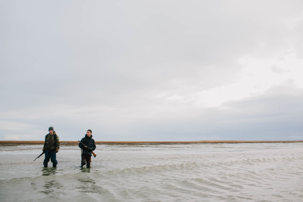 Travis Logusak (l) and Brekin Gosuk (r) on the Togiak Bay shore east of town after an unsuccessful duck hunt.